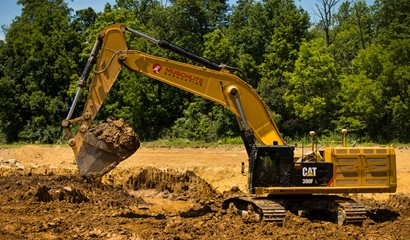 CAT Excavator digging at dirt